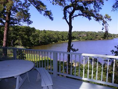 View of Swan Pond from deck at 32 Whistler Lane, South Dennis, MA for sale by Cranberry Real Estate 508-394-1700